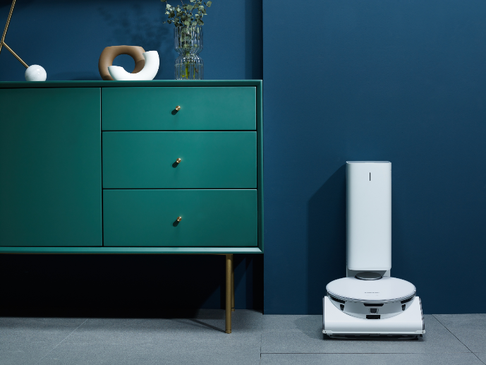 """<p>I'm not going to lie, Samsung had so many innovations it was hard to keep track. But as a diehard fan of <a href=""""https://www.housebeautiful.com/shopping/best-stores/g32645466/robot-vacuum-sales-may-2020/"""" rel=""""nofollow noopener"""" target=""""_blank"""" data-ylk=""""slk:robotic vacuums"""" class=""""link rapid-noclick-resp"""">robotic vacuums</a>—because who doesn't want to put up their feet, sip a glass of wine, and watch their floors get cleaned while streaming Bridgerton—the pain point is always the tiny little container that can fill pretty quickly. The new JetBot 90 AI heads back to the Clean Station and empties all the dirt into a bag that you only need to replace once every two to three months. That is GAME CHANGING. Clearly, it has all the advanced smart tech you desire, like a LiDAR sensor—think self-driving cars—that detects distance and tracks location, and it easily identifies and navigates around things like cords and vases. A big deal for those of us that are constantly putting our wine down to go unwind our vacs. It will be arriving on our shores the first half of 2021. </p>"""
