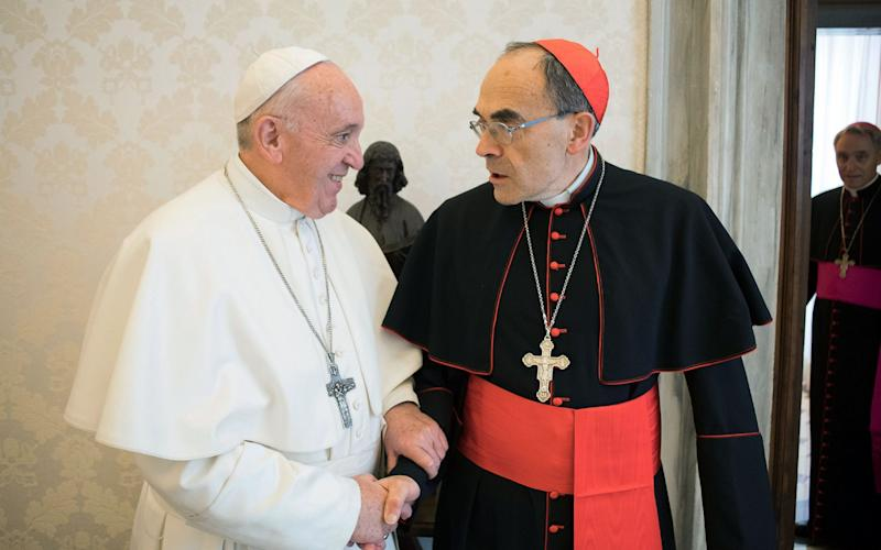 Pope Francis shaking hands with France's Cardinal Philippe Barbarin (R), during their meeting at the Vatican on March 18, 2019 - AFP
