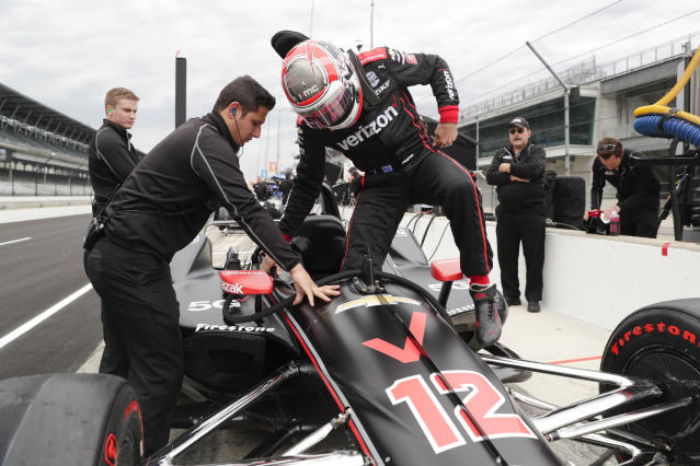 IndyCar driver Will Power, of Australia, climbs into his car during auto racing testing at the Indianapolis Motor Speedway in Indianapolis, Wednesday, April 24, 2019. (AP Photo/Michael Conroy)
