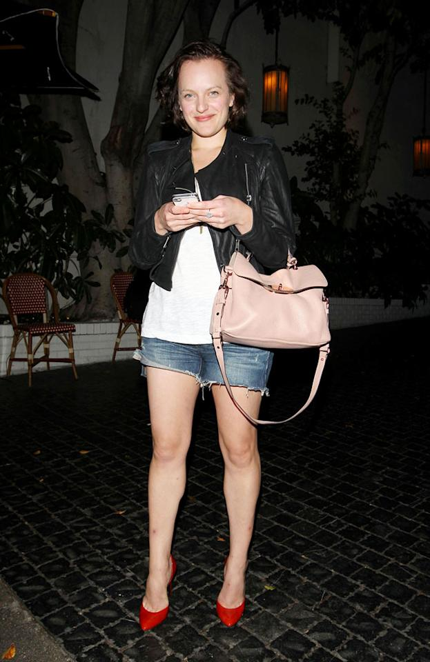 "Also spotted out and about ... ""Mad Men"" co-star Elisabeth Moss, who showed off her pasty white legs while unsuccessfully attempting to rock tiny denim shorts and red stilettos outside Hollywood's famed Chateau Marmont. Hellmuth Dominguez/<a href=""http://www.pacificcoastnews.com/"" target=""new"">PacificCoastNews.com</a> - September 28, 2011"