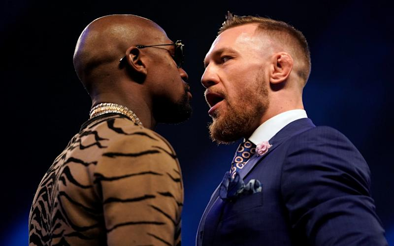 Conor McGregor and Floyd Mayweather Jr. face off during the Floyd Mayweather Jr. v Conor McGregor World Press Tour event at SSE Arena on July 14, 2017 in London - Zuffa LLC