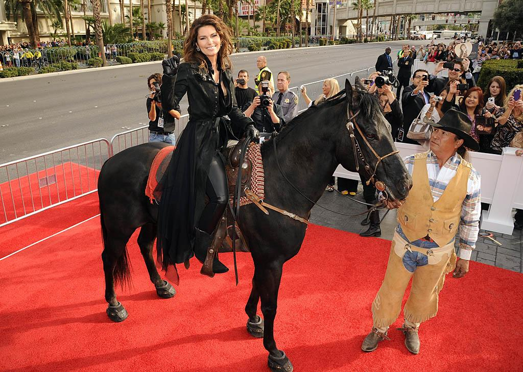 LAS VEGAS, NV - NOVEMBER 14:  Shania Twain celebrates Caesars Palace arrival with a horse stampede down Las Vegas Blvd on November 14, 2012 in Las Vegas, Nevada.  (Photo by Jason Merritt/WireImage)
