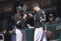 Chicago White Sox pitching coach Ethan Katz, left, greets starting pitcher Lance Lynn outside the dugout after Lynn retired the Minnesota Twins in the fifth inning of a baseball game Thursday, May 13, 2021, in Chicago. (AP Photo/Charles Rex Arbogast)