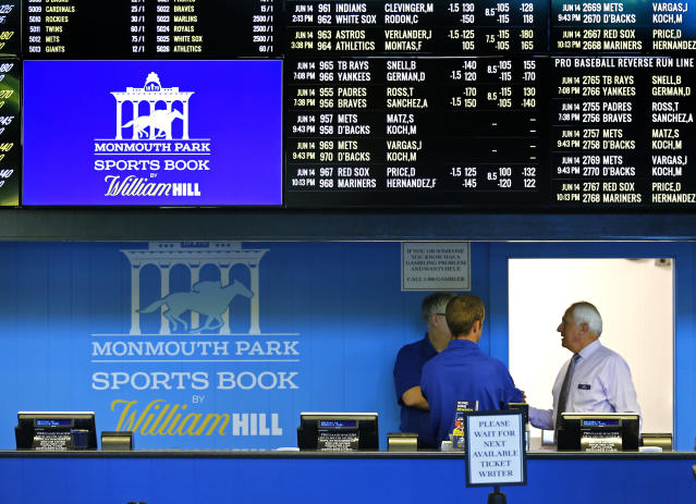 Ticket writers wait for the opening of Monmouth Park Sports Book at Monmouth Park Racetrack. Thursday, June 14, 2018 in Oceanport, NJ. (AP Photo/Noah K. Murray)