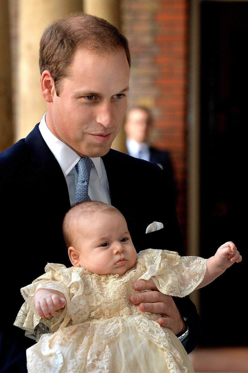 <p>Prince William holds Prince George as they arrive at Chapel Royal in St James's Palace for the baby's christening. </p>