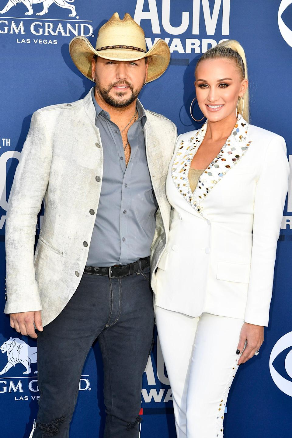 Jason Aldrin, left, with Brittany Kerr Aldin, walks the red carpet at the 54 Academy Awards for Country Music Awards on Sunday, April 7, 2019, in Las Vegas, Neva.