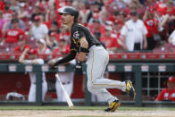 CORRECTS CITY TO CINCINNATI NOT COLUMBUS - Pittsburgh Pirates' Bryan Reynolds hits a two-run double off Cincinnati Reds relief pitcher David Hernandez in the eighth inning during the first baseball game of a doubleheader, Monday, May 27, 2019, in Cincinnati. (AP Photo/John Minchillo)