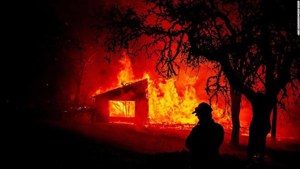"""<p>A building burns during the Glass Fire in St. Helena, California.</p><div class=""""cnn--image__credit""""><em><small>Credit: Josh Edelson/AFP/Getty Images / Getty Images</small></em></div>"""