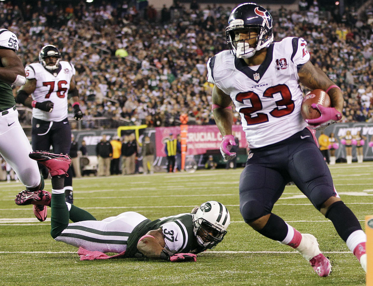 Houston Texans running back Arian Foster (23) rushes for a touchdown as New York Jets strong safety Yeremiah Bell (37) falls down on the play during the first half of an NFL football game, Monday, Oct. 8, 2012, in East Rutherford, N.J. (AP Photo/Kathy Willens)