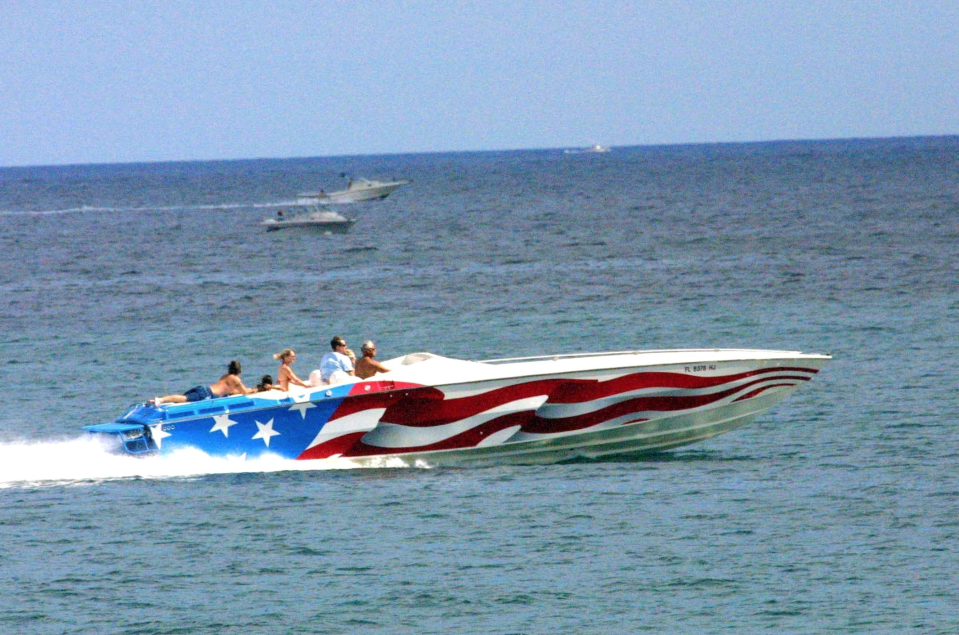Fun on the water in a red, white & blue speedboat. (Photo: SEITZ/Gamma-Rapho via Getty Images)