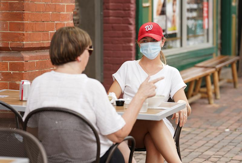 Months after closures from the coronavirus disease (COVID-19), diners sit outdoors at a restaurant as Northern Virginia began Phase One of reopening in Alexandria, Virginia, U.S., May 29, 2020. REUTERS/Kevin Lamarque