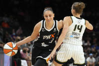 Phoenix Mercury guard Diana Taurasi drives on Chicago Sky guard Allie Quigley (14) during the first half of Game 2 of basketball's WNBA Finals, Wednesday, Oct. 13, 2021, in Phoenix. (AP Photo/Rick Scuteri)