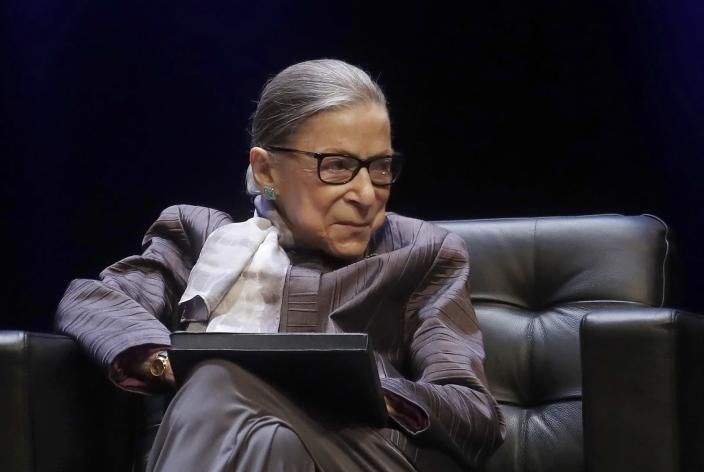 U.S. Supreme Court Justice Ruth Bader Ginsburg listens to speakers during the inaugural Herma Hill Kay Memorial Lecture at the University of California at Berkeley, Monday, Oct. 21, 2019, in Berkeley, Calif. (AP Photo/Jeff Chiu)