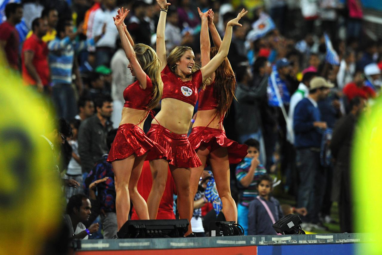 Cheerleaders perform after Chennal Super Kings won over Mumbai Indians by six wickets on October 20, 2012 during a Group B Champions League T20 (CLT20) match at Wanderers Stadium in Johannesburg.                 AFP PHOTO / ALEXANDER JOE
