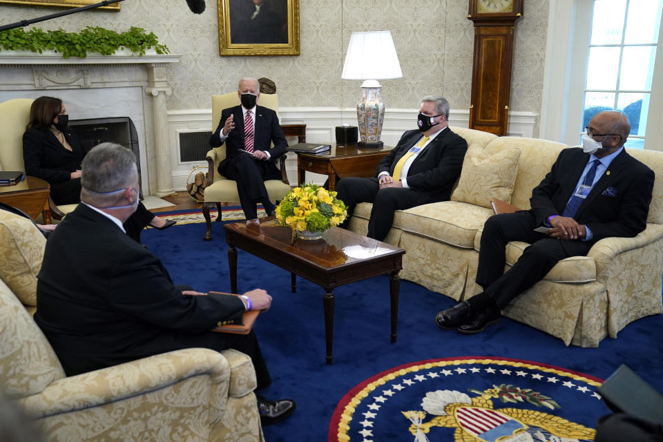 President Joe Biden and Vice President Kamala Harris meet with labor leaders in the Oval Office of the White House, Wednesday, Feb. 17, 2021, in Washington. Eric Dean, general president of the Ironworkers International Union, second from right, and Kenneth Rigmaiden, general president of the International Union of Painters and Allied Trades, right, listen. (AP Photo/Evan Vucci)