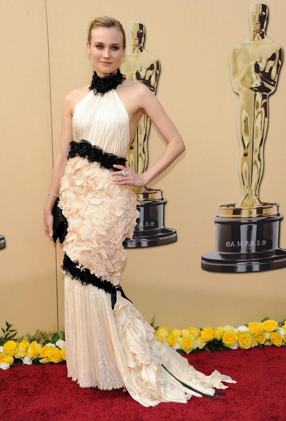 <p>Diane chose a cream and black dress by Chanel for the big show in 2010.</p>