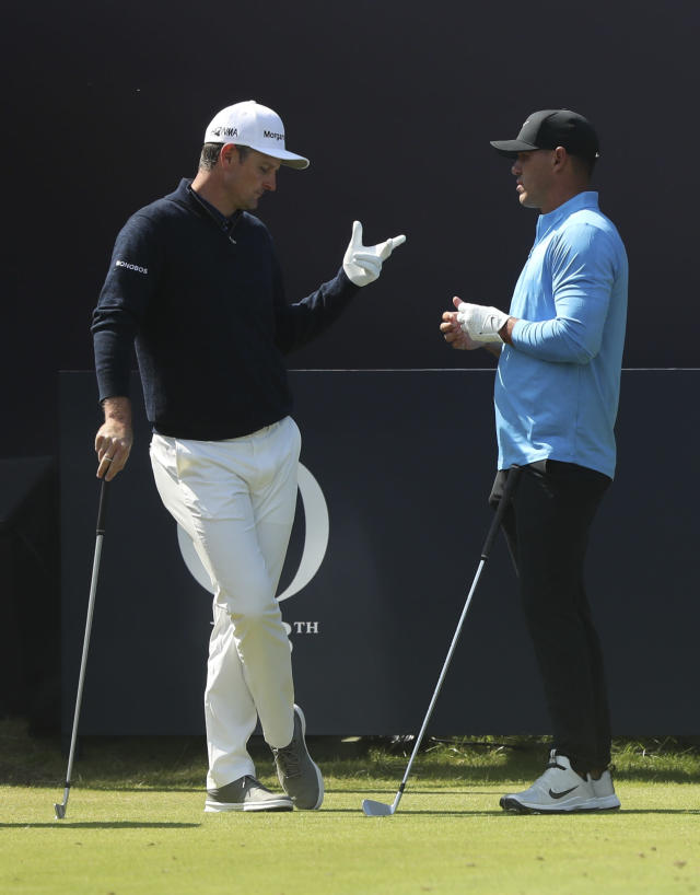 England's Justin Rose, left, speaks to Brooks Koepka of the United States on the 1st tee before they start their third round in British Open Golf Championships at Royal Portrush in Northern Ireland, Saturday, July 20, 2019.(AP Photo/Jon Super)