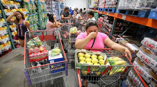 <p>Shoppers at Costco in Altamonte Springs, Fla., wait in line for the arrival of a shipment of water during preparations for the impending arrival of Hurricane Irma on Wednesday, Sept. 6, 2017. These residents waited in line starting at 7 a.m. for an 11 a.m. water delivery. (Photo: Joe Burbank/Orlando Sentinel/TNS via Getty Images) </p>
