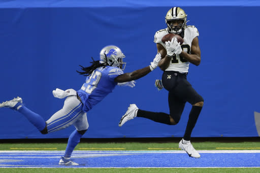 New Orleans Saints wide receiver Tre'Quan Smith, defended by Detroit Lions cornerback Desmond Trufant, catches a 20-yard pass for a touchdown during the first half of an NFL football game, Sunday, Oct. 4, 2020, in Detroit. (AP Photo/Duane Burleson)