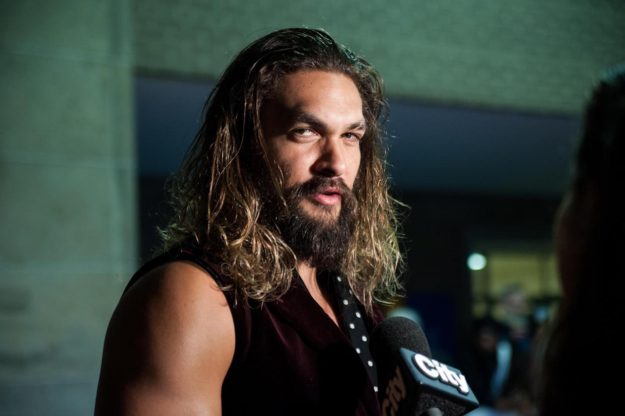 "Jason Momoa looks like a chic version of ""Batman's"" Joker in this"