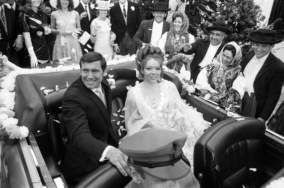 James Bond, played by George Lazenby, pictured marrying Tracey played by Diana Rigg during the filming of 'On Her Majesty's Secret Service' Estoril, Portugal, 30th April 1969. (Photo by Peter Stone/Mirrorpix/Getty Images)
