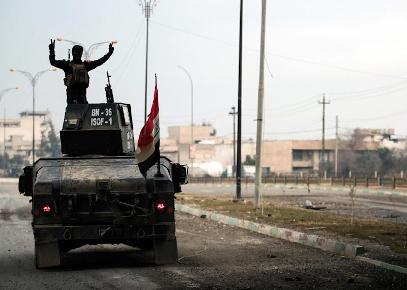 Iraqi forces battled the last holdout jihadists in east Mosul after commanders declared victory there and quickly set their sights on the city's west, where more tough fighting awaits