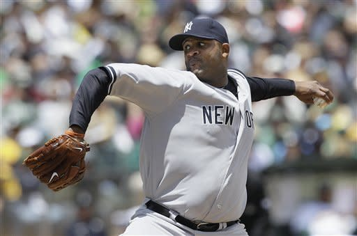 CORRECTS INNING TO SECOND, INSTEAD OF THIRD - New York Yankees' CC Sabathia pitches against the Oakland Athletics during the second inning of a baseball game in Oakland, Calif., Saturday, May 26, 2012. (AP Photo/Jeff Chiu)