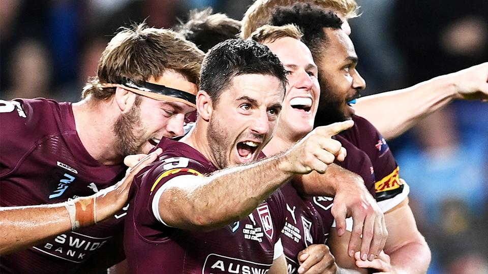 Ben Hunt (pictured) points after the Maroons score against New South Wales.