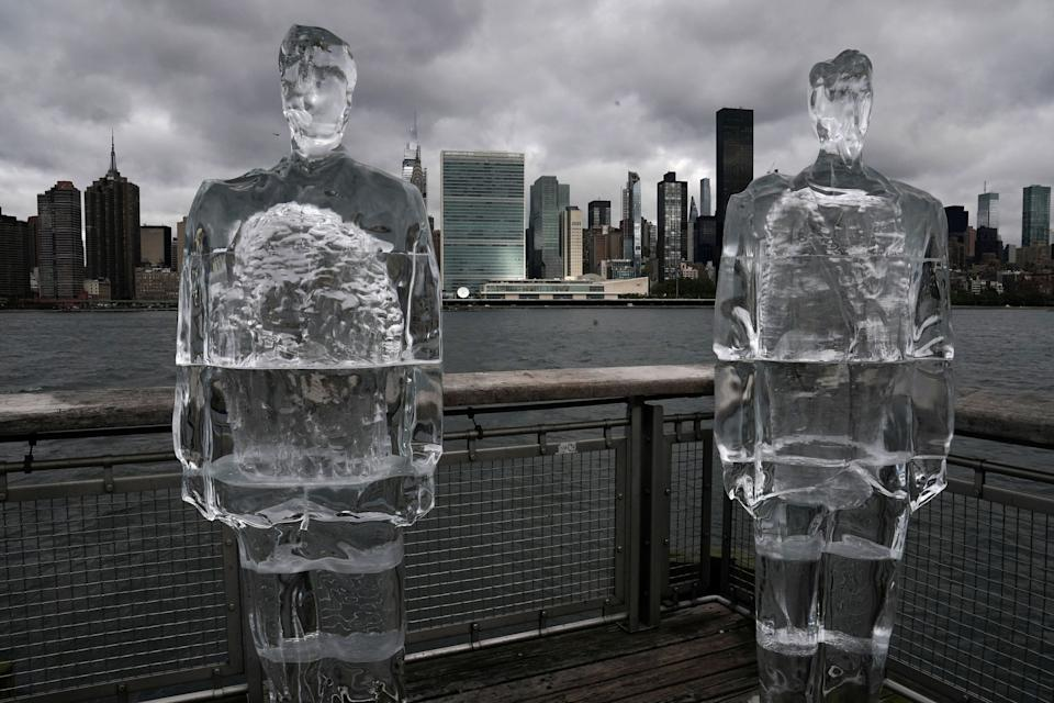 Two ice sculptures depicting U.S. President Donald Trump and Brazilian President Jair Bolsonaro sit across the Hudson River from the United Nations headquarters in New York City on Sept. 30, 2020. (Photo: Carlo Allegri / Reuters)