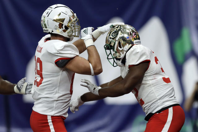 East running back Benny LeMay, of Charlotte, right, celebrates his touchdown against the West with tight end Mitchell Wilcox, of South Florida, (89) during the second half of the East West Shrine football game Saturday, Jan. 18, 2020, in St. Petersburg, Fla. (AP Photo/Chris O'Meara)