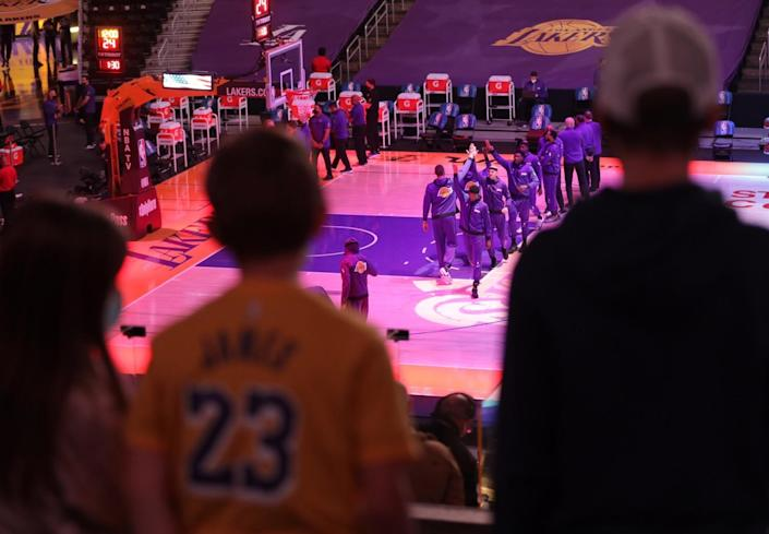 Fans and players stand for the national anthem before the Lakers-Celtics game.