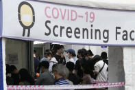 People wait to get coronavirus testing at a Public Health Center in Seoul, South Korea, Sunday, July 11, 2021. (AP Photo/Ahn Young-joon)