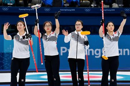 FILE PHOTO: Curling - Pyeongchang 2018 Winter Olympics - Women's Round Robin - Sweden v South Korea - Gangneung Curling Center - Gangneung, South Korea - February 19, 2018 - Kim Eun-jung, Kim Kyeong-ae, Kim Seon-yeong and Kim Yeong-mi of South Korea celebrate beating Sweden. REUTERS/Toby Melville/File Photo