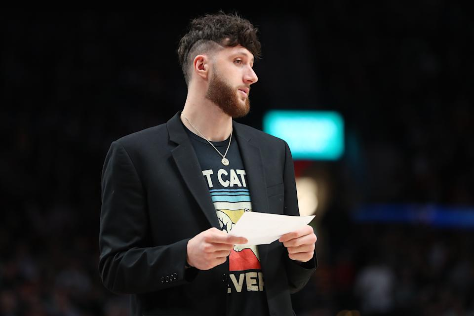 PORTLAND, OREGON - FEBRUARY 25: Jusuf Nurkic #27 of the Portland Trail Blazers reacts in the second quarter while injured against the Boston Celtics during their game at Moda Center on February 25, 2020 in Portland, Oregon. NOTE TO USER: User expressly acknowledges and agrees that, by downloading and or using this photograph, User is consenting to the terms and conditions of the Getty Images License Agreement. (Photo by Abbie Parr/Getty Images)