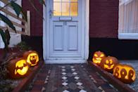<p>If you're getting dressed up, act as if you're trick-or-treating with this pumpkin path background. </p>