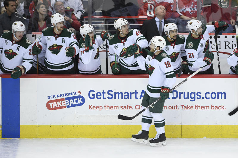 Minnesota Wild center Luke Kunin (19) is congratulated for his goal during the third period of an NHL hockey game against the Washington Capitals, Friday, March 22, 2019, in Washington. The Wild won 2-1. (AP Photo/Nick Wass)