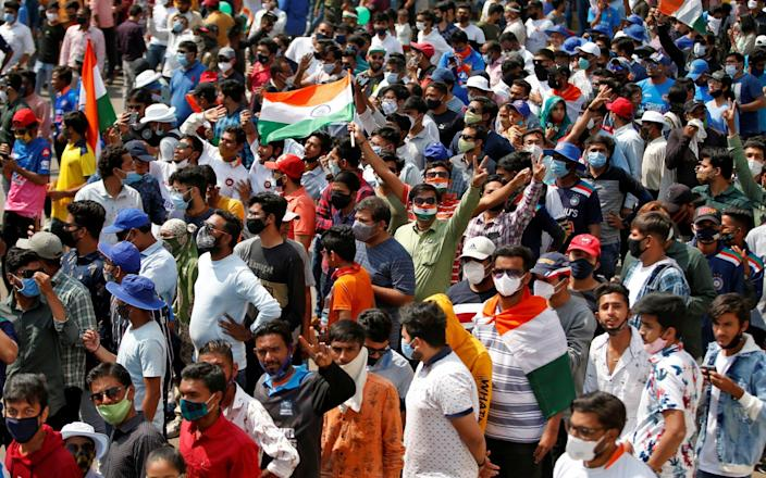 Fans react as they wait to enter the newly named Narendra Modi Stadium in India  - Amit Dave/Reuters