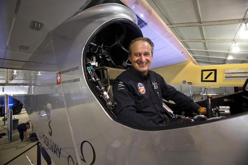 Andre Borschberg, one of two pilots of the Solar Impulse plane, poses for a portrait in the cockpit of the purely solar powered plane during a media availability at the Smithsonian National Air and Space Museum's Steven F. Udvar-Hazy Center at Washington Dulles International Airport in Chantilly, Va., Monday, June 17, 2013. The solar-powered plane nearing the close of a cross-continental journey landed at Dulles early Sunday, only one short leg to New York remaining on a voyage that opened in May. (AP Photo/Jacquelyn Martin)
