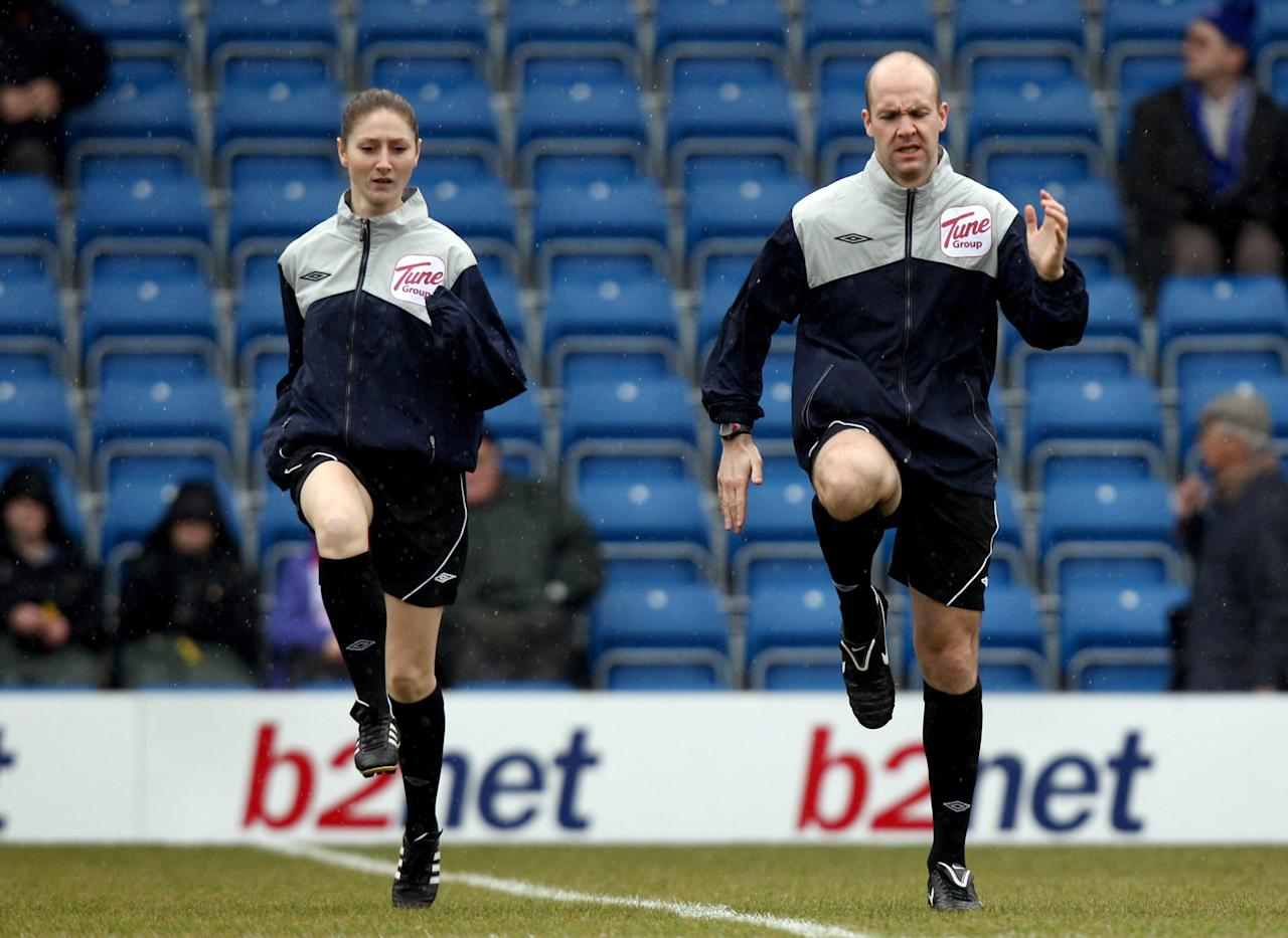 Assistant referee Sian Massey, left, and referee Anthony Taylor warm up before the League Two soccer match between Chesterfield and Aldershot Town, Chesterfield, England, Saturday Feb. 5, 2011.