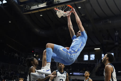 Creighton's Christian Bishop (13) dunks during the first half of an NCAA college basketball game against Butler, Saturday, Jan. 16, 2021, in Indianapolis. (AP Photo/Darron Cummings)
