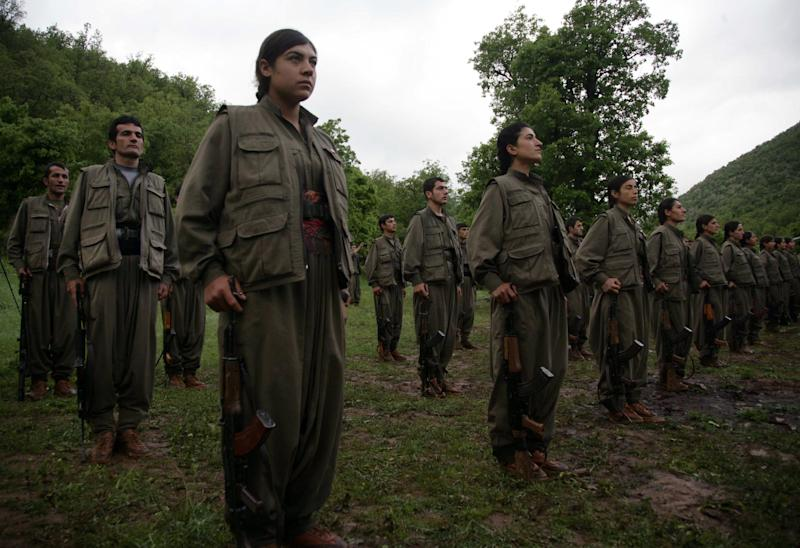 PKK forces stand to attention after arriving in the northern Iraqi city of Dohuk on May 14, 2013 (AFP Photo/Safin Hamed)