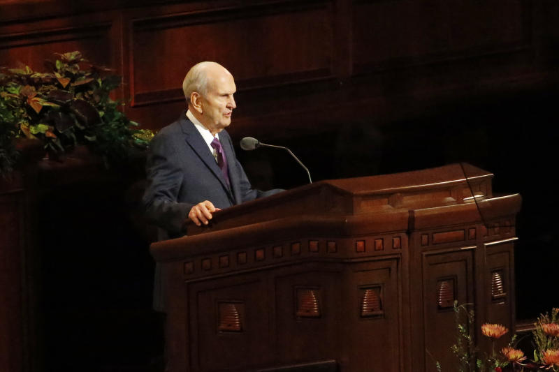 FILE - In this Oct. 5, 2019, file photo, President Russell M. Nelson speaks during The Church of Jesus Christ of Latter-day Saints' twice-annual church conference, in Salt Lake City. For the first time in more than 60 years, top leaders from The Church of Jesus Christ of Latter-day Saints will deliver speeches at the faith's signature conference this weekend without anyone watching in the latest illustration of how the coronavirus pandemic is altering worship practices around the world. The twice-yearly conference normally brings some 100,000 people to the church conference center in Salt Lake City to watch five sessions over two days. This event, though, will be only a virtual one. (AP Photo/Rick Bowmer, File)