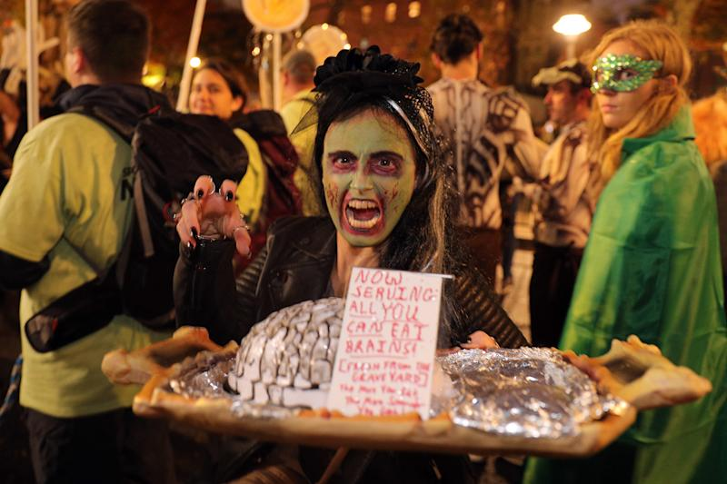 A woman in costume offers a tray of brains during Halloween Parade in New York City. (Photo: Gordon Donovan/Yahoo News)