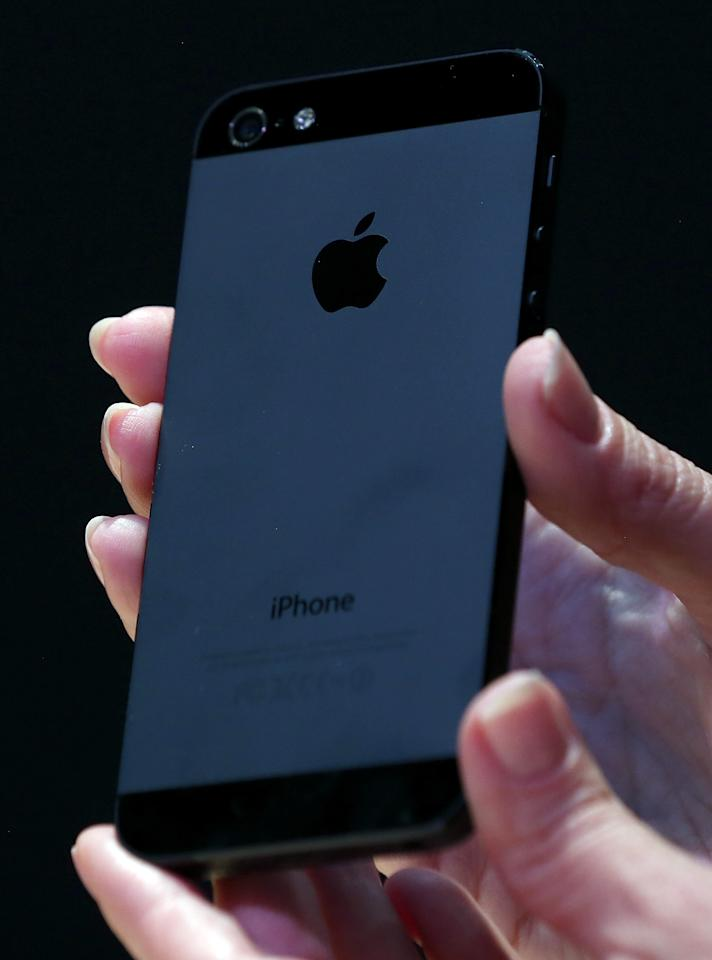SAN FRANCISCO, CA - SEPTEMBER 12:  The new iPhone 5 is displayed during an Apple special event at the Yerba Buena Center for the Arts on September 12, 2012 in San Francisco, California. Apple announced the iPhone 5, the latest version of the popular smart phone as well as new updated versions of the iPod Nano, Shuffle and Touch.  (Photo by Justin Sullivan/Getty Images)