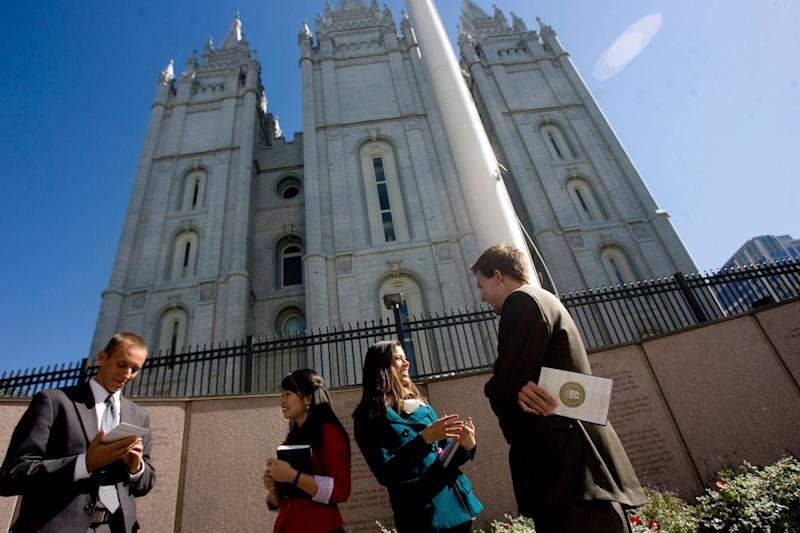 Missionaries Sister Khanitta Puttapong, center left, and Sister Christina Wong, center right, talk to Casey Ahlstrom, left, and Jason Mondon in Temple Square during the 182nd Semiannual General Conference of the Church of Jesus Christ of Latter-day Saints in Salt Lake City on Sunday, Oct, 7, 2012. (AP Photo/The Salt Lake Tribune, Kim Raff)