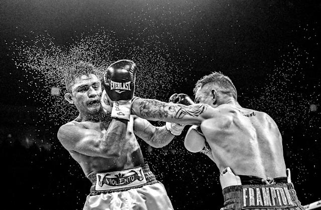 <p>Carl Frampton, right, in action against Horacio Garcia during their featherweight bout at the SSE Arena in Belfast. (Photo By Ramsey Cardy/Sportsfile via Getty Images) </p>