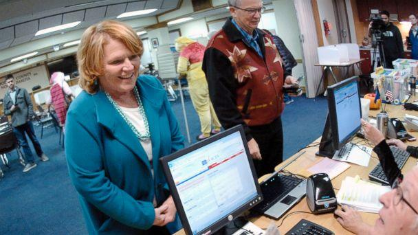 PHOTO: Sen. Heidi Heitkamp talks with a precinct worker before casting her vote at an early voting precinct inside the Morton County Courthouse, Oct. 31, 2018, in Mandan, N.D. (Mike McCleary/The Bismarck Tribune/AP)