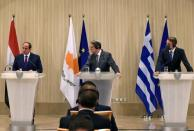 Cypriot President Nicos Anastasiades, Greek Prime Minister Kyriakos Mitsotakis and Egyptian President Abdel Fattah al-Sisi are seen during a news conference after a trilateral summit between Greece, Cyprus and Egypt, at the Presidential Palace in Nicosia