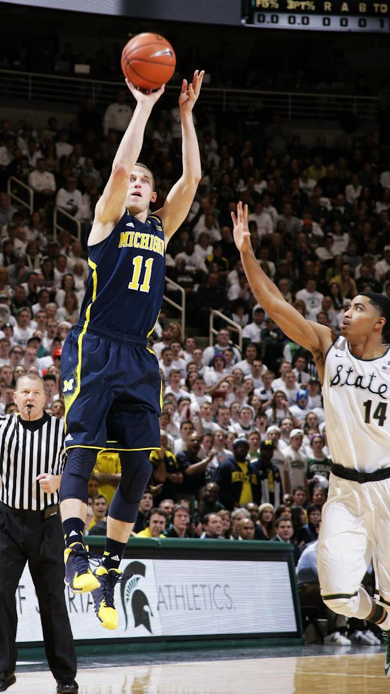 No. 21 Michigan beats No. 3 Michigan State 80-75