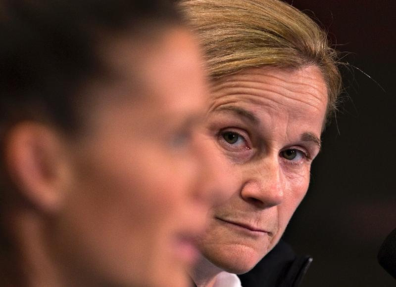 USA coach Jill Ellis (R) listens to player Ali Krieger answering questions at a press conference in Vancouver, on June 15, 2015